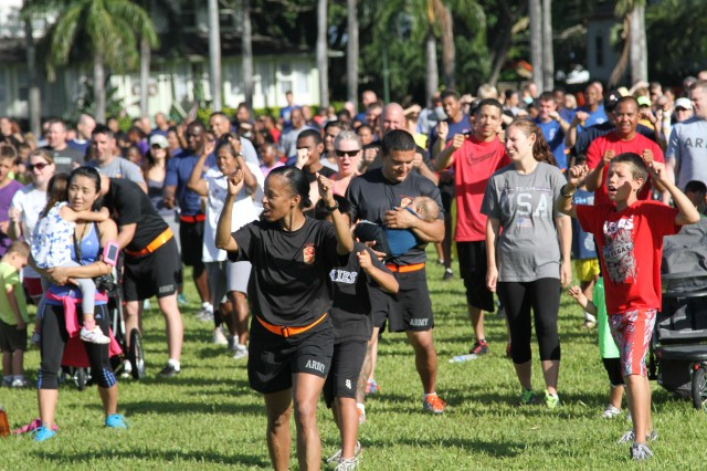 Soldiers, Leaders, Family members, and civilians gathered at the Historic Palm Circle for a 1.5-mile Family Fun Run to mark the start of Pacific Theater Army Week, June 9. PTAW honors the Army's 116-year presence in the Pacific region. After the weeklong activities the celebration will conclude with the 239th Army Birthday Commemoration celebration at the Hilton Hawaiian Village in Waikiki, June 13