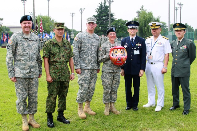 The U.S. Army Medical Department Activity- Japan welcomed their new commander during a change of command ceremony June 17 on Yano Field behind the Yano Fitness Center where Col. Vivian T. Hutson relinquished command of MEDDAC-J to Col. Thirsa Martinez. (U.S. Army photos by Kiyoshi Tokeshi)
