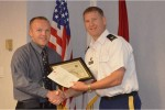 Mr. Robert Bastian receiving AT Honor Roll from COL Ferrell (SPK Cdr)