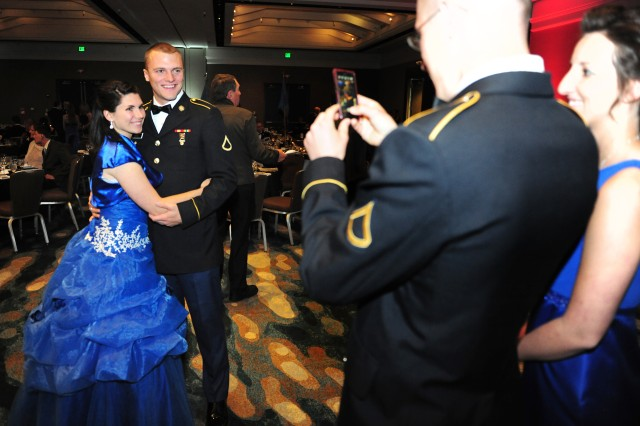 PRESIDIO OF MONTEREY, Calif. - A couple attending the 229th Military Intelligence Battalion Army Birthday Ball pose for photographs inside the Grand Ballroom of the Monterey Hyatt Regency Hotel June 7.