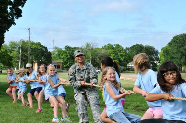 Capt. Nicole Kruse, 166th Aviation Brigade public affairs officer, joins the students in a tug-of-war match during the Gatesville Elementary Fun in the Sun Field Day in Gatesville, Texas, June 6. (Photo by Nicole Kruse, 166th Aviation. Brigade, Division West Public Affairs)