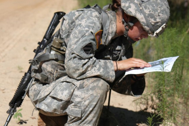 First Lt. Rachael Long, a platoon leader with Company C, 703rd Brigade Support Battalion, 4th Infantry Brigade Combat Team, 3rd Infantry Division, checks her map before leaving the road to find her first point at the day land navigation course during Expert Field Medical Badge testing on Fort Stewart, Ga., June 10, 2014. (Photo by Sgt. Joshua Laidacker, 4th IBCT, 3rd ID, Public Affairs)