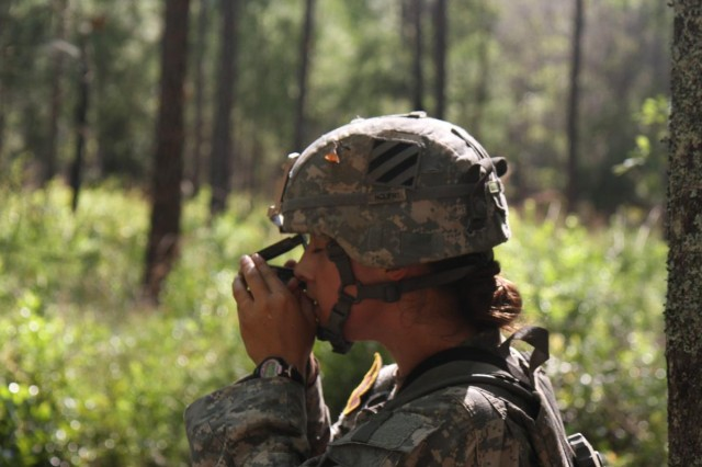 First Lt. Rachael Long, a platoon leader with Company C, 703rd Brigade Support Battalion, 4th Infantry Brigade Combat Team, 3rd Infantry Division, looks through her compass to confirm her heading at the day land navigation course during Expert Field Medical Badge testing on Fort Stewart, Ga., June 10, 2014. (Photo by Sgt. Joshua Laidacker, 4th IBCT, 3rd ID, Public Affairs)