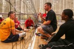 Coach J.D. Malone gives advice to Soldiers and Veterans at sitting volleyball practice at the 2014 U.S. Army Warrior Trials