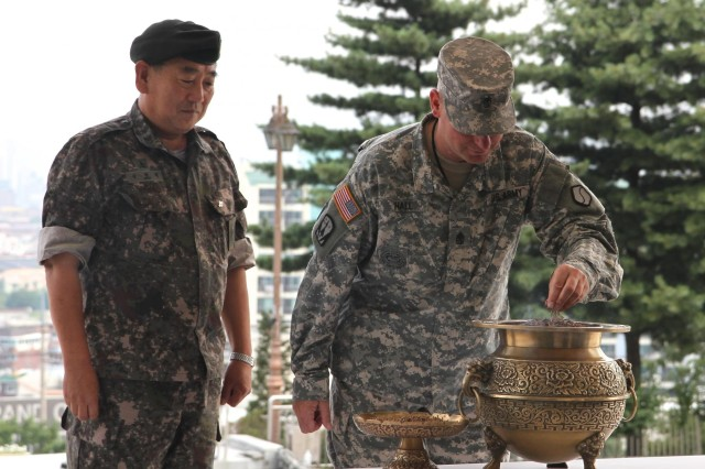 Sgt. Maj. Prentiss E. Hall, 19th ESC G-3 sergeant major, and the 5th LSC's command sergeant major, Command Sgt. Maj. Sin Young-jik, honor the war dead with a ceremonial offering at the Apsan memorial park, June 18.