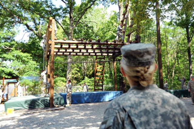 U.S. Army Reserve Maj. Gen. Leslie Purser, commanding general, 108th Training Command (Initial Entry Training), observes Cadets negotiate an obstacle on the Confidence Course during Cadet Summer Training (CST) on Fort Knox, Ky., June 16. The Rappel Tower/ Confidence Course Committee will explain, demonstrate, and provide qualified safety personnel for Cadets to negotiate the Rappel Tower and all obstacles within the Confidence Course. Task Force Wolf, comprised of Soldiers from the 104th Training Division and various other supporting Reserve units, provides U.S. Army Reserve Trainers as cadre to various committees to facilitate CST, which educates and trains college students to be potential officers and leaders in the U.S. Army. (U.S. Army photo by Staff Sgt. Shejal Pulivarti/released)