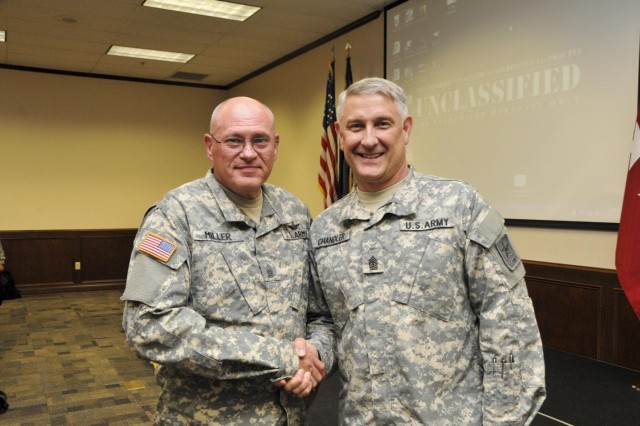 Sgt. Maj. of the Army Ray Chandler met with Command Sgt. Maj. George Miller, the state command sergeant major of the Mississippi National Guard. Earlier in his career, Chandler was assigned to the Army National Guard in Mississippi. The reunion meeting between the two senior non-commissioned officers took place at the 2014 Army National Guard's Senior Enlisted Professional Development Workshop held at Atterbury-Muscatatuck in Edinburgh, Ind. Attendees included the most senior non-commissioned officers in the Army National Guard from every state and territory and the District of Columbia.