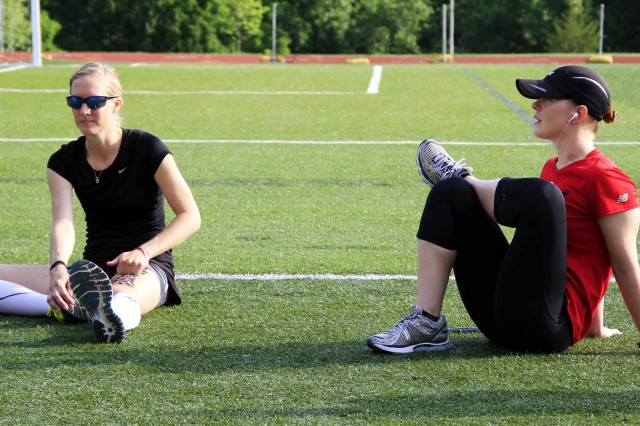 From Left: U.S. Army Veteran, Anne Oravec from Denver, Colorado, stretches with U.S. Army Reservist, Chief Warrant Officer 2, Kimberly Hendrix, Warrior Transition Unit, Fort Bliss, Texas, before competing in the open women's 100 meter race held at the United States Military Academy Preparatory School track in West Point, N.Y., on June 17, 2014.  The U.S. Army Warrior Trials are hosted by the Army Warrior Transition Command and results help determine the athletes who will make up team Army for the 2014 Warrior Games Sep 28 -- Oct 4.