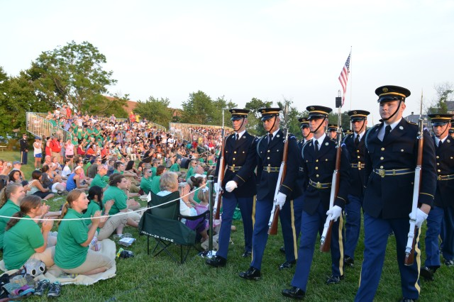 "Soldiers from the 3rd U.S. Infantry Regiment (The Old Guard), and the U.S. Army Band ""Pershing's Own,"" perform during Twilight Tattoo held at Joint Base Myer-Henderson Hall, Va., June 18, 2014."