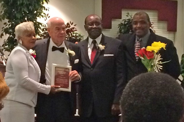 Dr. Bill Craig, second left, receives the Government & Industry Award from Mrs. Georgia Valrie, president of Huntsville Progressive Alumni Chapter of Alabama A&M University.