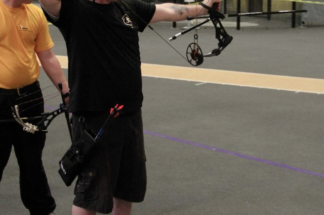Spc. Harrell competes in archery at the 2014 U.S. Army Warrior Trials