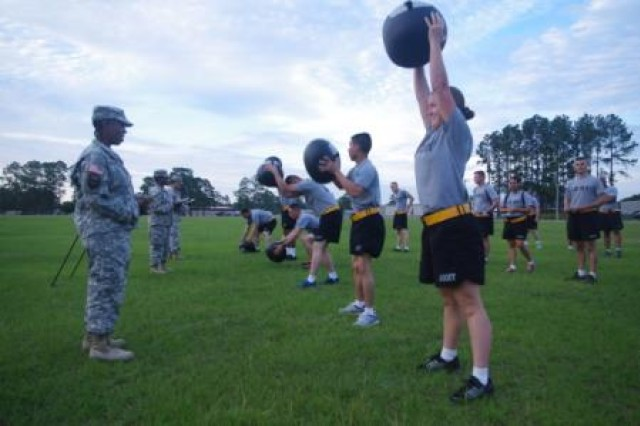 Soldiers of the HHB, 42nd FiB perform Ball Slam repetitions during a special PT session at Donovan Field, June 11. The PT session was part of a Sexual Harassment/Assault Response and Prevention training stand-down that the Wheel Horse Brigade hosted. (U.S. Army Photo by Staff Sgt. Aaron Knowles, 42nd Fires Brigade, 3rd Infantry Division)