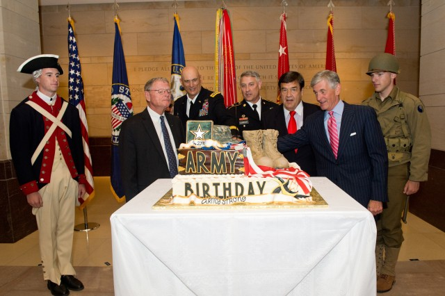 Army leaders and members of Congress participate in a cake-cutting ceremony at the Capitol, June 18, 2014, during a celebration of the Army's 239th birthday. Participating in the cutting are: Secretary of the Army John M. McHugh; Chief of Staff of the Army Gen. Ray Odierno; Sgt. Maj. of the Army Raymond F. Chandler III; Rep. Dutch Ruppersberger, of Maryland; and, Sen. James M. Inhofe, of Oklahoma.