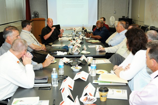 Senior management participates in QASAS discussions during a training session held at the Rock Island Arsenal, June 16 -19.