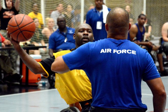 Army and Air Force athletes compete in the wheelchair basketball final game at the 2014 Warrior Trials.