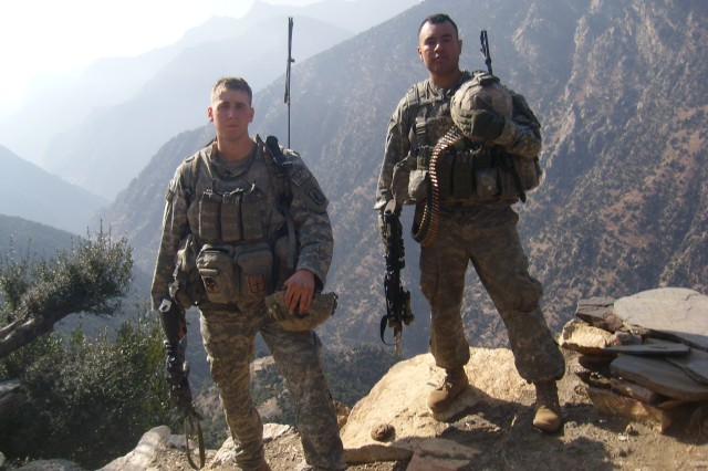 Sgt. Ryan Pitts (left) and Sgt. Israel Garcia patrol the mountains of eastern Afghanistan. Garcia was among the nine Soldiers killed in the battle in Wanat, July 13, 2008.