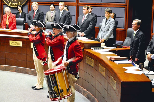Members of the U.S. Army's Old Guard perform prior to the start of the Fairfax County Board of Supervisors meeting, Tuesday.