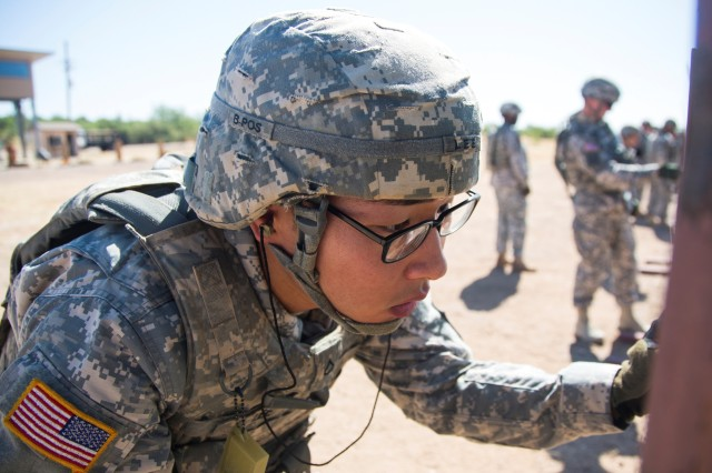 Spc. Andrew Lee, representing the 311th Signal Command (Theater), examines his target at the zero range June 10, during the Network Enterprise Technology Command Best Warrior Competition at Fort Huachuca, Ariz.