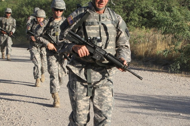 Staff Sgt. John Mitchell, representing the 160th Signal Brigade, leads the way during the combat ruck march event June 10, during the Network Enterprise Technology Command Best Warrior Competition at Fort Huachuca, Ariz.