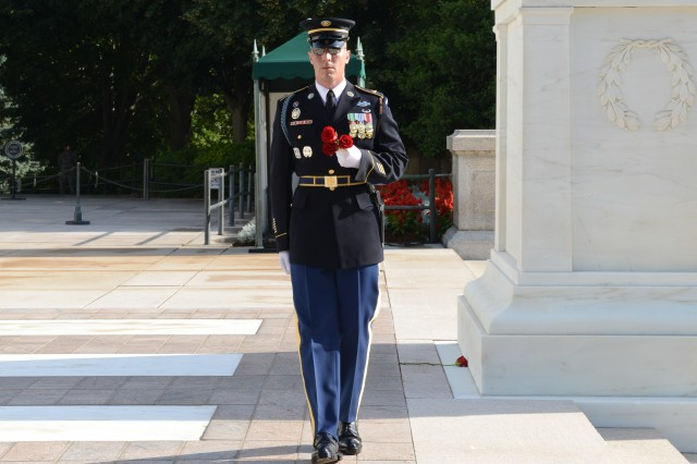 Sgt. 1st Class Tanner M. Welch, Sergeant of the Guard, Tomb of the Unknown Soldier, 3rd U.S. Infantry Regiment (The Old Guard), places a rose at each of the crypts of the Unknowns during his last walk  and rose laying ceremony in Arlington National Cemetery, Va., June 19, 2014.