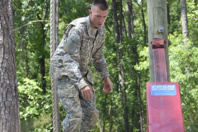 Sgt. 1st Class Andrew Dunham, Company B, 187th Ordnance Battalion, prepares to jump off an obstacle at the Confidence Course, June 10, 2014. Dunham won Fort Jackson's Platoon Sergeant of the Year competition.