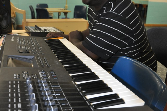 Brian Manigo, music program director for the Fort Jackson Youth Center, leads a group at the center that gives students the opportunity to write and record their own music. Since the program's beginning in 2011, participants have recorded five albums.