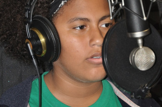 Summer Peters, 12, lays down a vocal track at the Fort Jackson Youth Center recording studio.
