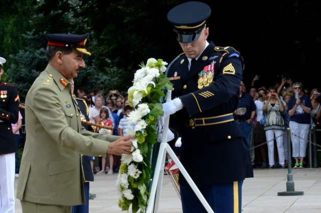 Gen. Rashad Mahmood, 16th Chairman of the Joint Chiefs of Staff Committee of Pakistan, lays a wreath during an Armed Forces Full Honors Wreath Laying ceremony at the Tomb of the Unknown Soldier at Arlington National Cemetery, Va., June 19, 2014.