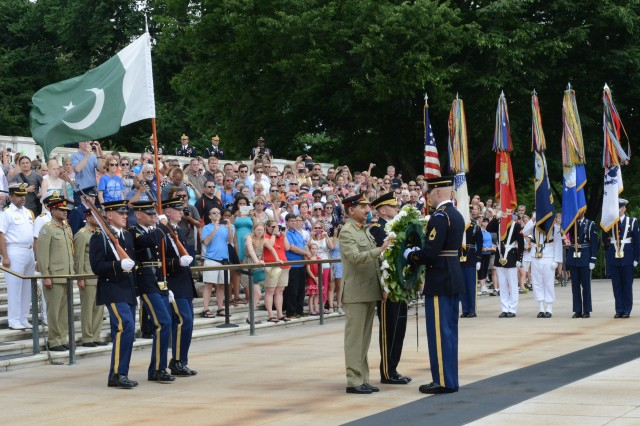 Gen. Rashad Mahmood, 16th Chairman of the Joint Chiefs of Staff Committee of Pakistan, prepares to lay a wreath during an Armed Forces Full Honors Wreath Laying ceremony accompanied by Maj. Gen Jeffery S. Buchanan, U.S. Army Military District of Washington commanding general, at the Tomb of the Unknown Soldier in Arlington National Cemetery, Va., June 19, 2014.