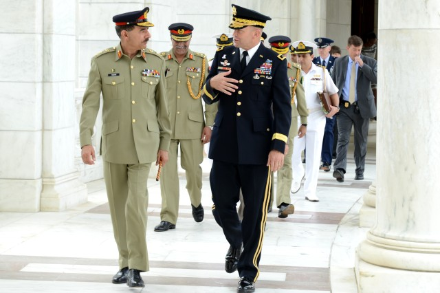 Maj. Gen Jeffery S. Buchanan, U.S. Army Military District of Washington commanding general, explains the Armed Forces Full Honors Wreath Laying ceremony to Gen. Rashad Mahmood, 16th Chairman of the Joint Chiefs of Staff Committee of Pakistan at Arlington National Cemetery, Va., June 19, 2014.
