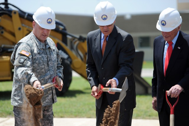 Lt. Gen. Mark Milley, III Corps and Fort Hood commanding general, Texas Governor Rick Perry and Arnold Fisher, honorary chairman, Intrepid Fallen Heroes Fund, grab their shovels during the NICoE Satellite Center groundbreaking ceremony at Fort Hood, Texas, June 12, 2014.