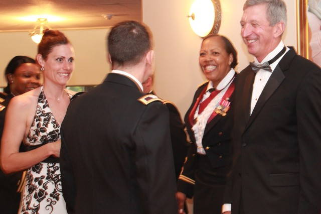 Maj. Gen George Weightman and COL Glenda Lock greet attendees as the pass through the recieving line during the recent Army Birthday Ball celebration.