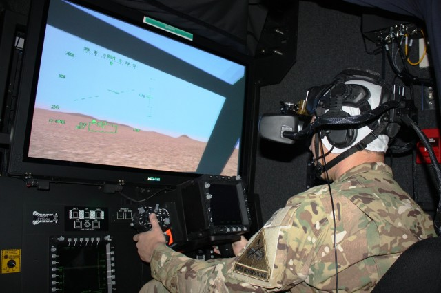 A 1st Armored Division Soldier trains on the Aviation Combined Arms Tactical Trainer, at Fort Bliss, Texas. The exercise combined live, virtual and constructive training as part of the Integrated Training Environment. The Integrated Training Environment is evolving to a single synthetic environment that combines constructive, gaming and virtual systems and is coupled with live training. This evolution was a topic at the Training and Education 2025 and Beyond Industry Forum, held June 18-19, 2014, at Fort Eustis, Va.