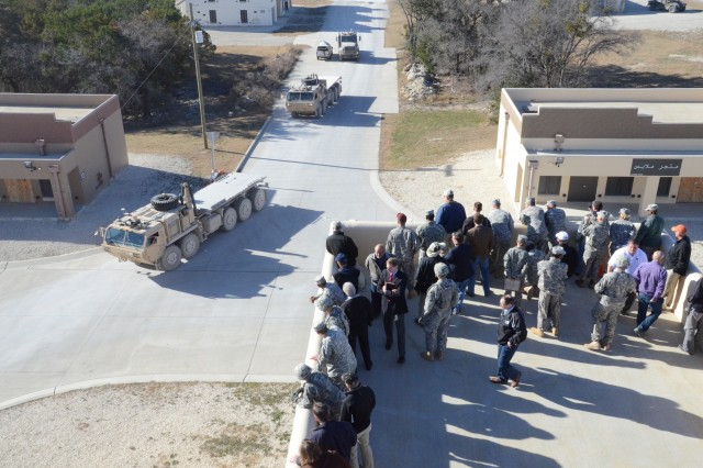 VIPs watch the Autonomous Mobility Applique System demonstration from the top of a building in the BOAZ Military Operations in Urban Terrain training site at Fort Hood, TX.