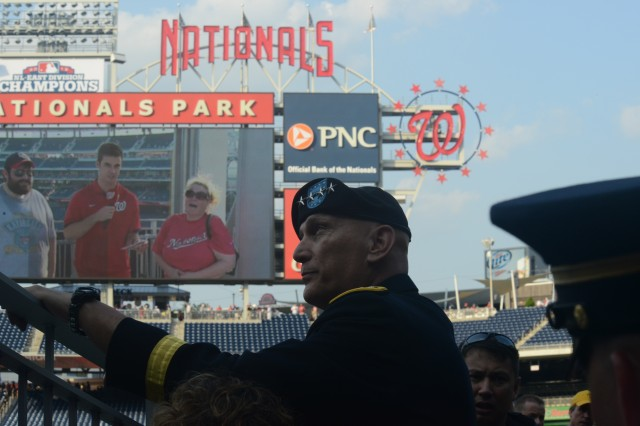 Army Chief of Staff Gen. Raymond T. Odierno looks onto the field prior to throwing out the first pitch in celebration of Army Day at Nationals Park in Washington, D.C., June 18, 2014.