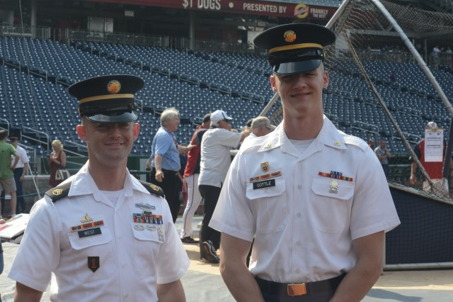Staff Sgt. Jacob C. West, with Headquarters Company, the 3rd U.S. Infantry Regiment (The Old Guard), and Spc. Vincent A. Cottle, H-HC Regiment, the 3rd U.S. Infantry Regiment (The Old Guard), stand for a photo during Washington Nationals batting practice prior to the clubs Army Day celebration.