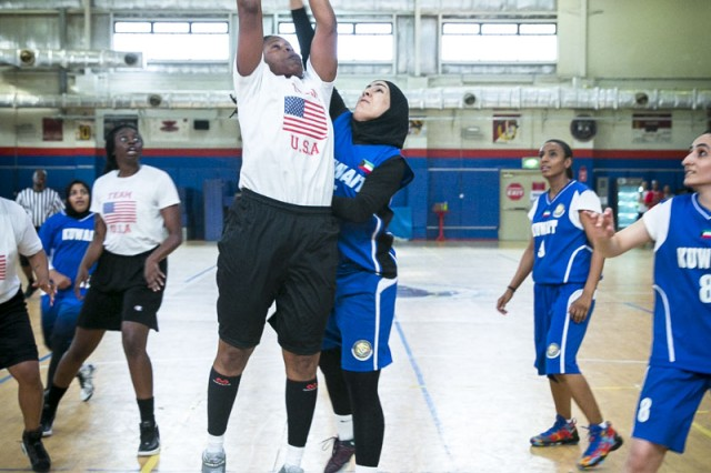 Tonya Weaver, 402nd Army Field Support Brigade, goes up for a shot during the Team USA vs. Team Kuwait game, at Camp Arifjan, Kuwait, May 24. Team USA won the game 43-36. (Photo courtesy Camp Arifjan MWR)