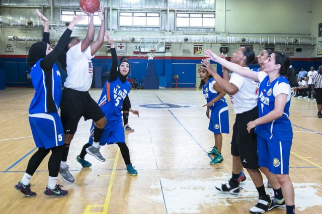 Tonya Weaver, 402nd Army Field Support Brigade, cuts through two defenders during the Team USA vs. Team Kuwait game, at Camp Arifjan, Kuwait, May 24. Team USA won the game 43-36. (Photo courtesy Camp Arifjan MWR)