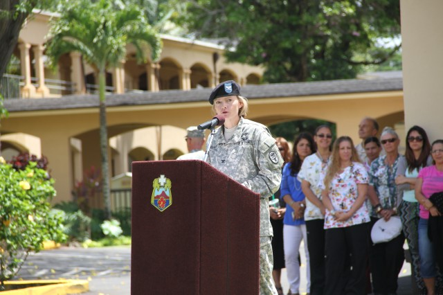 Col. Mary Krueger, outgoing commander for Schofield Barracks Health Clinic provides parting remarks during the SBHC change of command ceremony June 19, 2014 at Schofield Barracks, Hawaii.