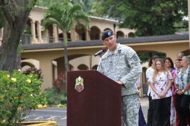 Col. Pete Eberhardt, newly appointment Schofield Barracks Health Clinic (SBHC) Commander addresses attendees during the SBHC Change of Command Ceremony June 19, 2014.