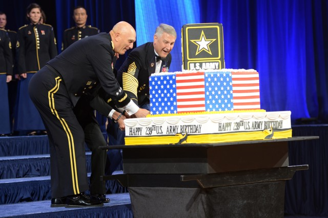 Chief of Staff of the Army Gen. Ray Odierno, Secretary of the Army John M. McHugh (obscured in the center), and Sgt. Maj. of the Army Raymond F. Chandler III, cut the birthday cake during the 2014 Army Birthday Ball, June 21, 2014, at National Harbor, Md.