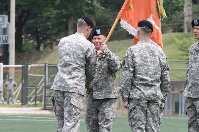 Lt. Col. Dan R. Brue II receives the Battalion colors from Col. Paul H. Fredenburgh III, Commander of 1st Signal Brigade to officially take over the command of the 41st Signal Battalion during the Change of Command ceremony at United States Army Garrison Yongsan, South Korea, 16 Jun. 2014. (U.S. Army Photo by KATUSA Sgt. Jong Soo Oh)
