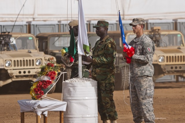 Three service members each hold a flag during the opening day ceremony of Exercise Western Accord. One service member holds the American flag, one the Economic Community of West African States flag and one the Senegalese flag. The service members will raise the flags officially signifying the beginning of Exercise Western Accord, June 16. Exercise Western Accord is a U.S. Africa Command sponsored and U.S. Army Africa led annual joint training partnership exercise between the United States, the Economic Community of West African States and partner nations. The exercise, held in Senegal this year, is designed to increase interoperability between military forces and ensure the common ability to conduct peace operations throughout western Africa.