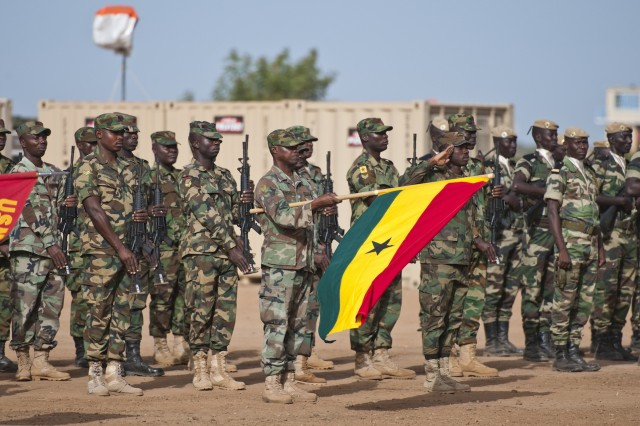 Ghana Engineers and Senegalese Paratroopers stand in formation during the opening day ceremony of Exercise Western Accord, June 16. Exercise Western Accord is a U.S. Africa Command sponsored and U.S. Army Africa led annual joint training partnership exercise between the United States, the Economic Community of West African States and partner nations. The exercise, held in Senegal this year, is designed to increase interoperability between military forces and ensure the common ability to conduct peace operations throughout western Africa.