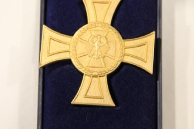The German Ehrenkreuz der Bundeswehr in Gold (Gold Cross of Honour).