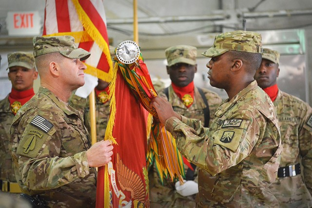 Lt. Col. Michael S. Knapp, commander of the 39th Joint Movement Control Battalion, and Command Sgt. Maj. Gussie Bernard Bellinger case their battalion's colors during a transfer of authority ceremony at Bagram Air Field, Afghanistan, on Nov. 18, 2013. The battalion, home stationed at Kaiserslautern, Germany, was replaced by the 330th Movement Control Battalion from Fort Bragg, North Carolina.