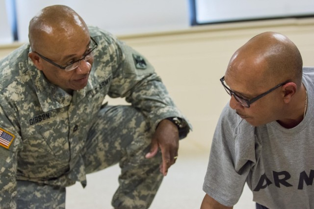 Sgt. 1st Class Andrew Gibson, of Pearl, Mississippi, pretends to argue with Sgt. 1st Class Fredrick Conley, of Vicksburg, Mississippi, during a sexual assault and harassment presentation to test Soldiers from the 2014 Army Reserve Best Warrior Competition at Joint Base McGuire-Dix-Lakehurst, New Jersey, June 22. (U.S. Army photo by Sgt. 1st Class Michel Sauret)