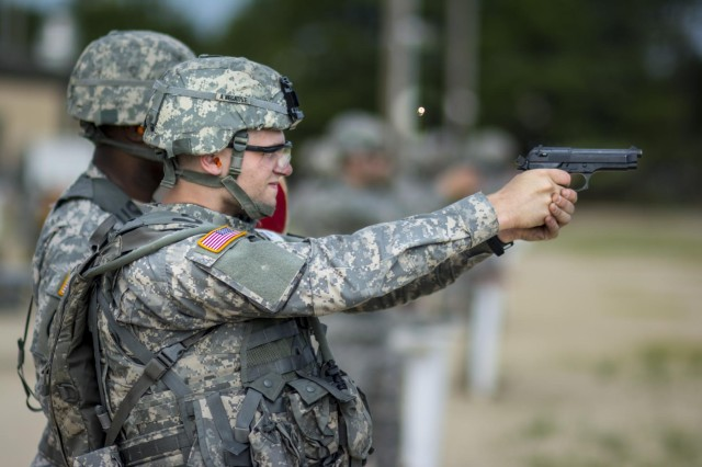 Spc. Gregory P. Doty, resident of Lake Peekskill, N.Y., an allied trade specialist with the 854th Engineer Battalion, fires a 9mm pistol at pop-up targets during a marksmanship range at Joint Base McGuire-Dix-Lakehurst, New Jersey, for the 2014 Army Reserve Best Warrior Competition June 23. Doty is competing in the Soldier category, representing the 412th Theater Engineer Command. (U.S. Army photo by Sgt. 1st Class Michel Sauret)