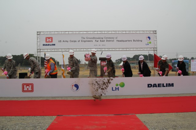 Col. Bryan S. Green (5th from left), commander and engineer of U.S. Army Corps of Engineers Far East District and Republic of Korea Brig. Gen. Kang Chang-koo (5th from right), Director General of Program Management, Ministry of Defense United States Forces Korea Relocation Office are joined by other dignitaries as they break ground on the district's headquarters building.