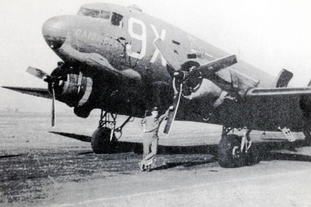 Gene Noble, then an Army Air Corps second lieutenant, is pictured alongside a C-47 he flew in World War II.